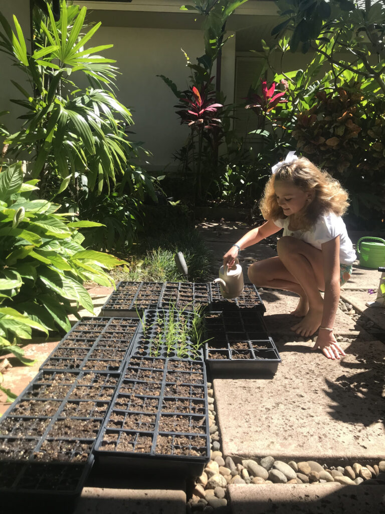 Abby Rogers waters her plants